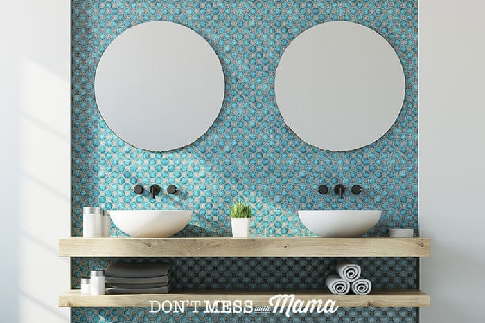 Photo of bathroom with two mirrors and two sinks