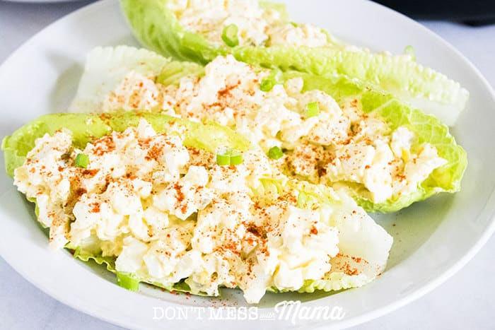 A closeup of egg salad on lettuce with an Instant Pot in the background