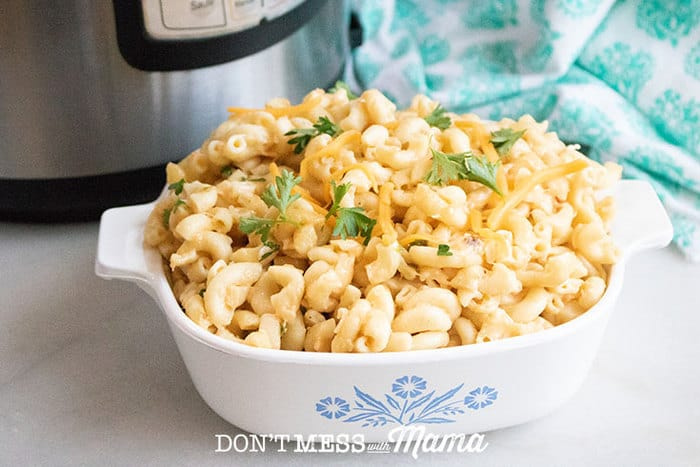 Closeup of a bowl of gluten-free mac and cheese with an Instant Pot in the background