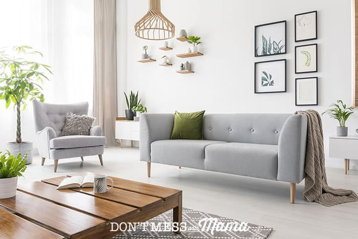 Photo of clean, modern living room with sofa and coffee table
