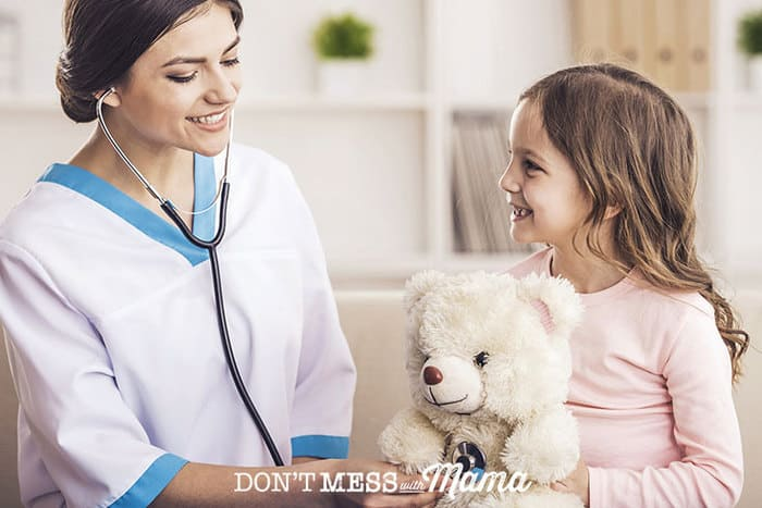 Closeup of nurse with a stethoscope and a young girl