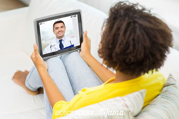 Woman on a couch using an iPad to talk to a doctor via telemedicine