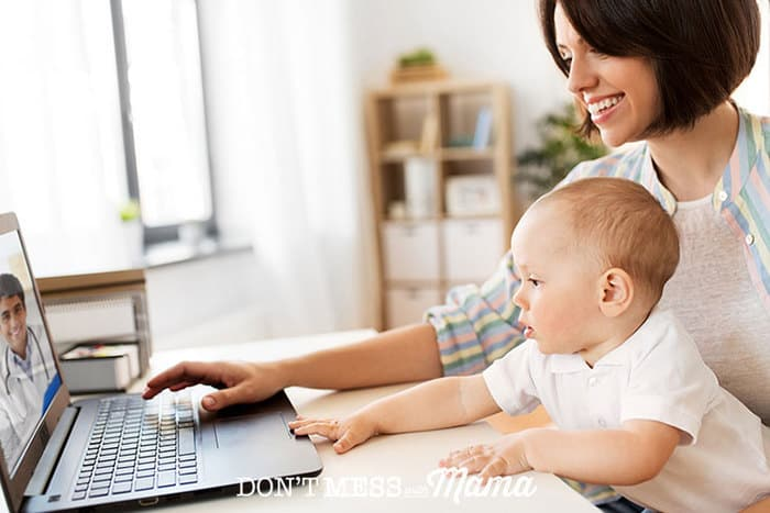 Mother and baby on a laptop talking to a doctor via telemedicine