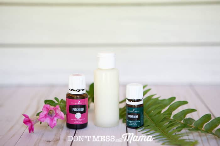 DIY Body Wash in a bottle next to two bottles of essential oils
