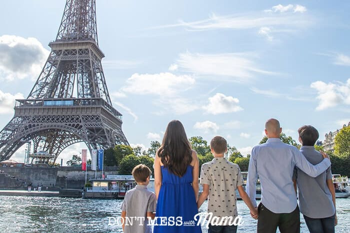 Family looking at the Eiffel Tower in Paris, France