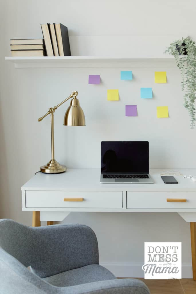 minimalist desk with lamp and sticky notes