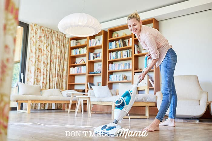 Woman using an electric mop to clean the floor