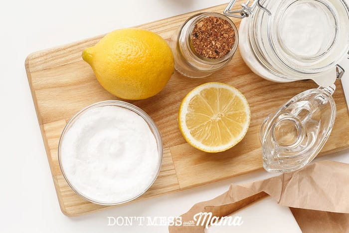 baking soda, lemons, vinegar on a table - natural cleaning ingredients