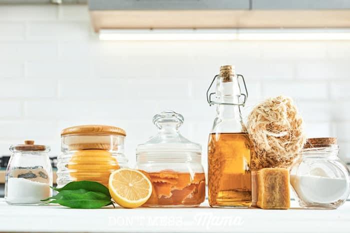 baking soda, lemons, vinegar, on a table for natural cleaning