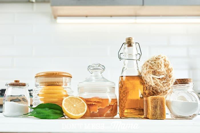 baking soda, lemons, vinegar, on a table for natural cleaning hacks