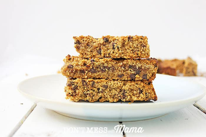 peanut butter protein granola bars stacked on a white plate