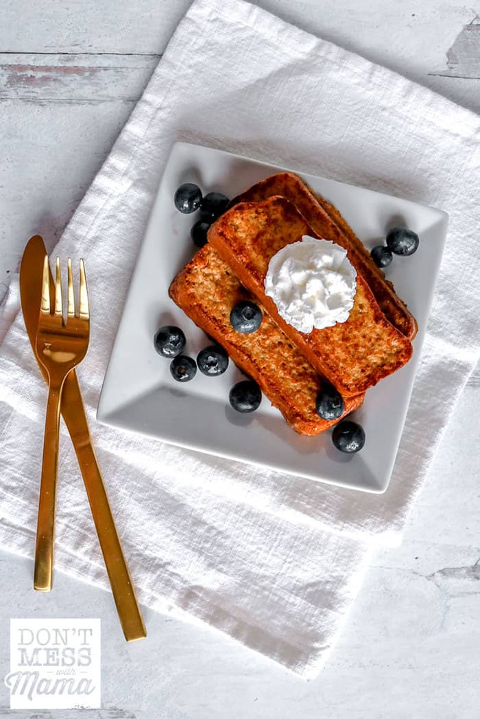 Keto french toast on a white plate with blueberries
