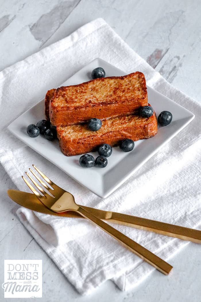 low-carb french toast on a white plate with blueberries