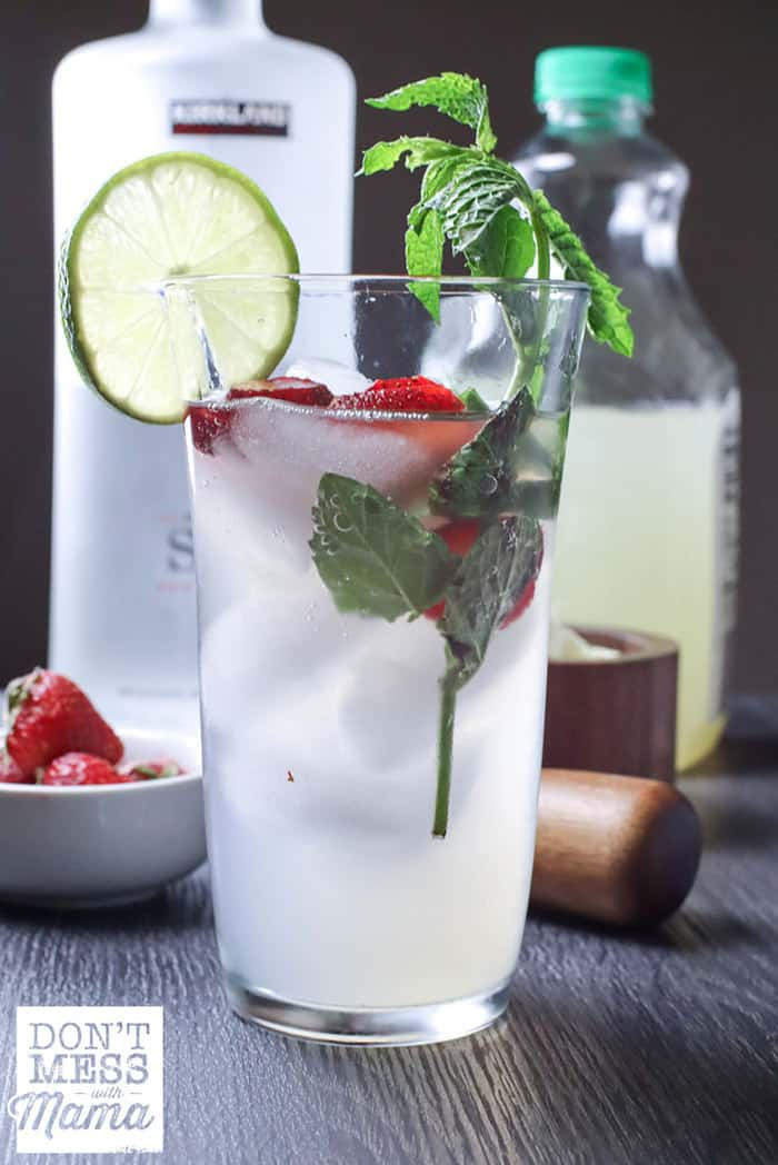 moscow mule in a tall glass with strawberries, lime and mint