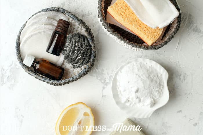 Cleaning supplies and essential oils on a table