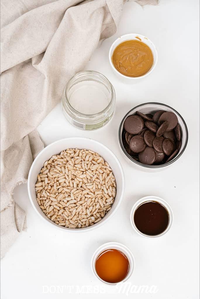 ingredients to make puffed rice bars like chocolate, puffed rice and honey
