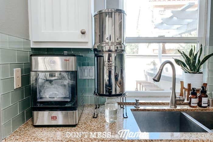 Berkey water filter on counter top in kitchen next to ice machine
