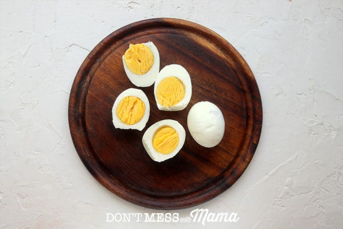 BROWN PLATE WITH SLICED BOILED EGGS